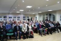 Zdjęcie przedstawia uczestników spotkania w sali w GCK w Białej