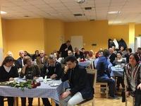 Zdjęcie przedstawia publiczność zebraną podczas spotkania